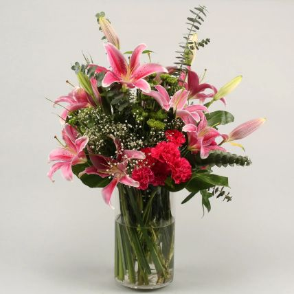 Gorgeous Flowers In Cylinder Vase: Exotic Flowers Delivery