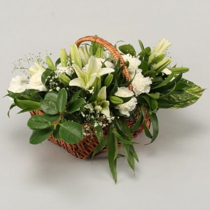 White Lilies & Carnations In Handle Cane Basket: Exotic Flowers