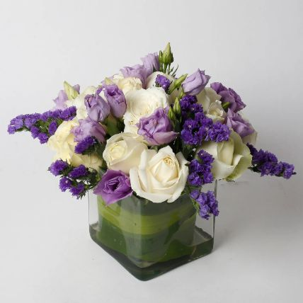 Fascinating White Roses Purple Flowers in Glass Vase