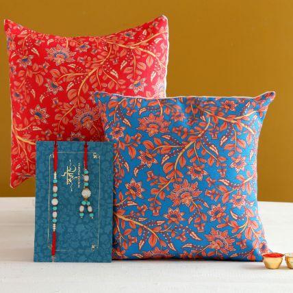 Blue Lumba Rakhi Set And 2 Floral Print Cushions