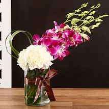 White Carnations & Orchids In Vase